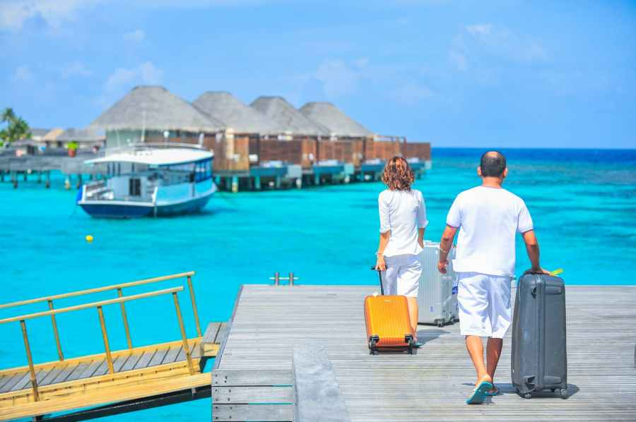 man and woman walks on dock